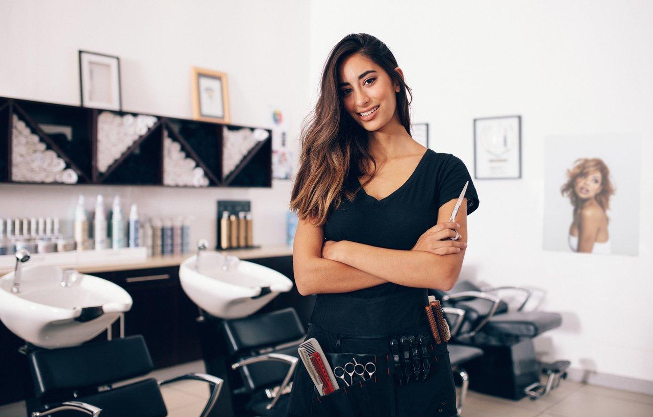 Hair stylist standing in a beauty salon
